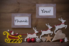 Santa Claus Sled And Reindeer, Frame With Thank  You Stock Photo