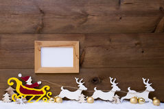 Santa Claus Sled, Reindeer, Snow, Copy Space, Golden Ball, Frame Stock Image
