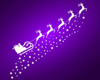 Santa Claus in sled rides in the  reindeer on a purple backg Royalty Free Stock Photos