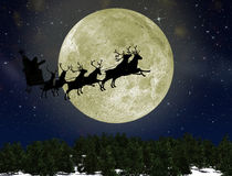 Santa Claus On Sledge With Deer. Against the bright moon. Concept eve of New year Royalty Free Stock Photos