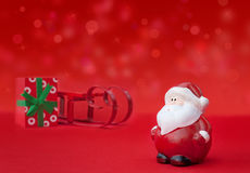Santa Claus with sledge and present Stock Photography
