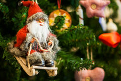 Santa Claus on a sledge toy on Christmas tree Stock Photo