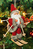 Santa Claus on a sledge toy on Christmas tree Stock Photography