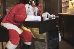 Santa claus sleep at the bar. Too drunk. A Santa claus sleep at the bar. Too drunk stock photography