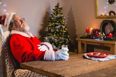 Santa Claus sleeping on chair stock image