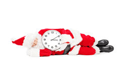 Santa Claus sleeping with a clock and running late Royalty Free Stock Image