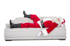 Santa claus sleeping on the couch Stock Photos