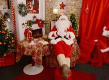 Santa Claus sleeping at his home stock image