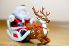 Santa Claus in a sleigh. Santa Claus and his faithful friend go deer distributed gifts to children Stock Image