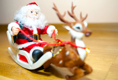 Santa Claus in a sleigh. Santa Claus and his faithful friend go deer distributed gifts to children Royalty Free Stock Image