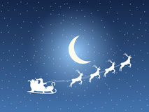 Santa Claus in a sleigh on a background of the moon and stars. Santa`s sleigh.  Stock Photos