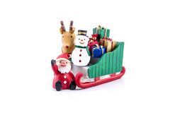 Santa claus in sleigh carrying a gifts with reindeer and snowman Stock Images