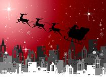 Santa Claus with sleigh fly over city at night Royalty Free Stock Photography