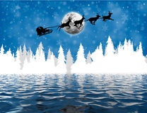 Santa Claus in sleigh over lake Royalty Free Stock Image