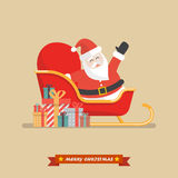 Santa claus on a sleigh with piles of presents Royalty Free Stock Photography