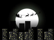 Santa Claus in a sleigh in a reindeer sleigh flying over the city. Santa Claus in a sleigh on a background of the moon. Vector Stock Photos
