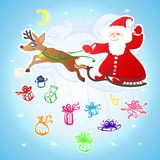 Santa Claus in a sleigh, which pulls the deer surrounded by gift Stock Image