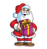 Santa Claus Smiling adn som kommer med gåvan Arkivfoto