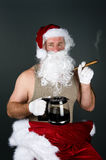 Santa Claus smoking a cigar Stock Image