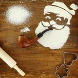 Santa Claus smoking pipe Stock Images