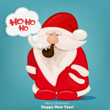 Santa Claus with smoking pipe and speech bubble. Stock Photo