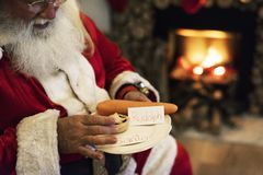 Santa Claus with snack in Christmas holiday stock images