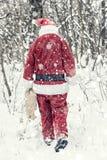 Santa Claus in sneeuwonweer royalty-vrije stock foto