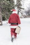 Santa Claus in sneeuwonweer stock afbeelding
