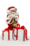 Santa Claus on snow with gift boxes - toy, isolated on white bac Royalty Free Stock Photos