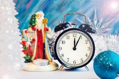 Santa Claus, Snow girl and alarm clock. Stock Images