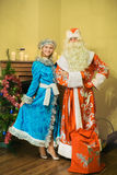 Santa Claus and snow maiden came to visit on new year Royalty Free Stock Images