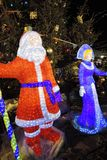 Santa Claus and Snow Maiden. Christmas and New Year 2018 decorations and Christmas Fair on the Red Square in Moscow. Christmas carousel and Saint Basils royalty free stock photography