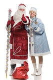 Santa Claus and snow maiden giving thumbs-up sign Stock Photos