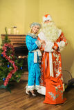 Santa Claus and snow maiden, new year is celebrated royalty free stock image