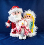 Santa Claus with snow Maiden and snowman. Knitting simbol.  royalty free stock images