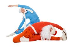 Santa Claus and the Snow Maiden of yoga Royalty Free Stock Photo