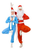 Santa Claus and the Snow Maiden of yoga. Royalty Free Stock Image