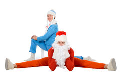 Santa Claus and the Snow Maiden of yoga. Royalty Free Stock Images