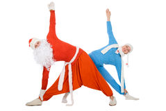 Santa Claus and the Snow Maiden of yoga Stock Photography