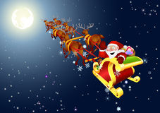 Santa Claus on snow sledge. Santa Claus snow sledge under moon and stars Royalty Free Stock Photo