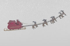 Santa Claus and snow weather. Santa Claus taking off his sleigh led by reindeers on snow weather Stock Images