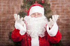 Santa Claus and snowfall Stock Photo