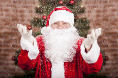 Santa Claus and snowfall Stock Photos