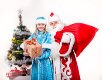 Santa Claus with snowgirl Stock Image