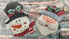 Santa Claus and the Snowman stock images
