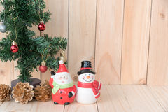 Santa claus and snowman with the christmas tree Stock Photos
