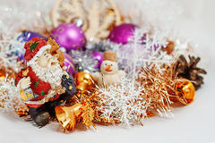 Santa Claus with a snowman. Father Christmas Santa Claus with a snowman in the tinsel. among Christmas balls and Christmas decoration Stock Photos