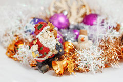 Santa Claus with a snowman. Father Christmas Santa Claus with a snowman in the tinsel. among Christmas balls and Christmas decoration Stock Image