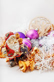 Santa Claus with a snowman. Father Christmas Santa Claus with a snowman in the tinsel. among Christmas balls and Christmas decoration Royalty Free Stock Images