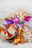 Santa Claus with a snowman. Father Christmas Santa Claus with a snowman in the tinsel. among Christmas balls and Christmas decoration Royalty Free Stock Photos